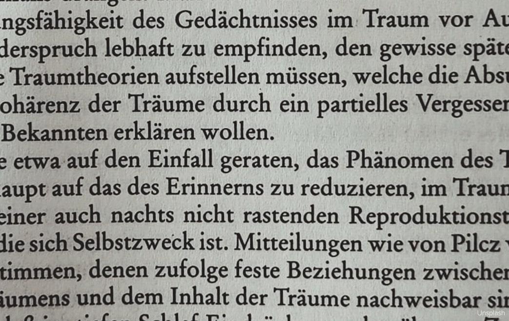 Textauszug aus einem deutschen Buch. Dialekte werden schriftlich kaum überliefert.